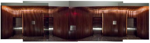 Conrad Hotel Elevator Lobby - a tunnel of bent walnut, fabricated by Pure Timber LLC