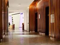 A tunnel of curved walnut, 46' long. Every guest of the Conrad Hotel passes through this elevator lobby fabricated by Pure Timber LLC