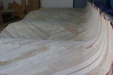 The cold-molded deck is 1/2 inch thick before the final layer of 1/8 inch thick walnut goes on